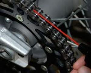 motorcycle chain maintenance - chain lube application - www.MotorbikeLicense.com